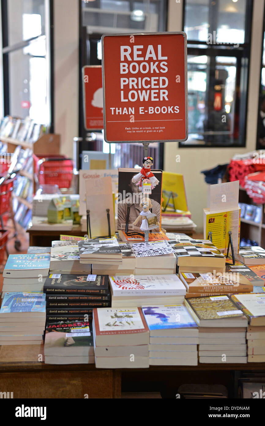 A sign for lowe priced books at the Strand Book Store in Greenwich Village New York City for items lower priced - Stock Image