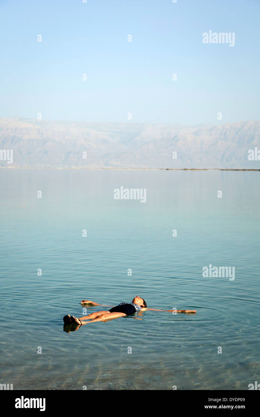 woman floating at the Dead Sea, Israel. - Stock Image