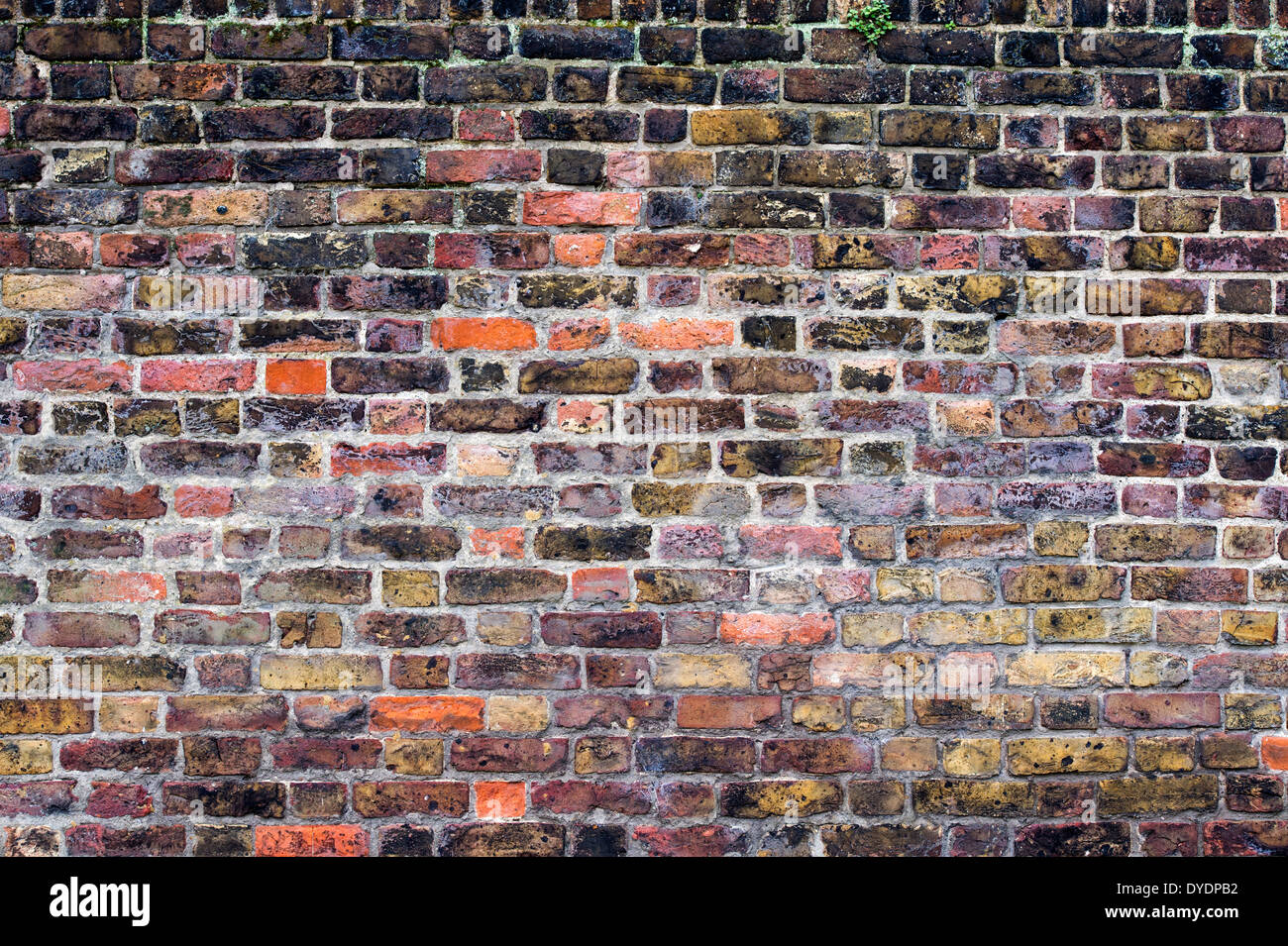 Colourful textured London Brick Wall - Stock Image