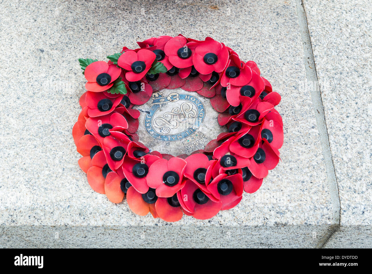 Poppy Wreath on Guards Division Memorial that honours dead soldiers of 5 regiments of World Wars -  Horse Guards Road, London - Stock Image
