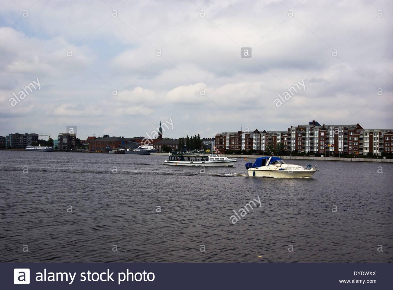 Hafenrundfahrt Emden takes tourists on round trip cruise in Jade Bight (Jadebusen) at Wilhelmshaven, Germany. - Stock Image