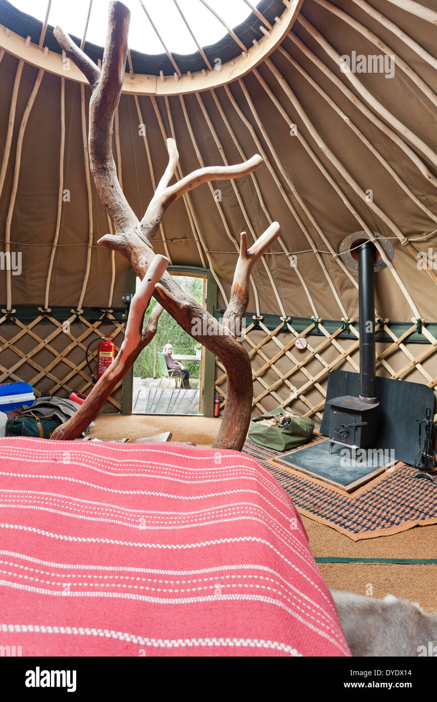 The interior of the yurt 'Coracle' at the luxury glamping site Crafty Camping at Holditch, Dorset UK - Stock Image