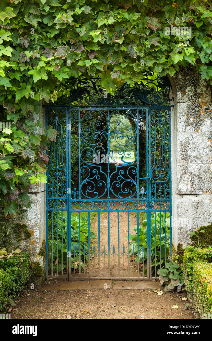 The Ornate Wrought Iron Gate To The Walled Garden Of