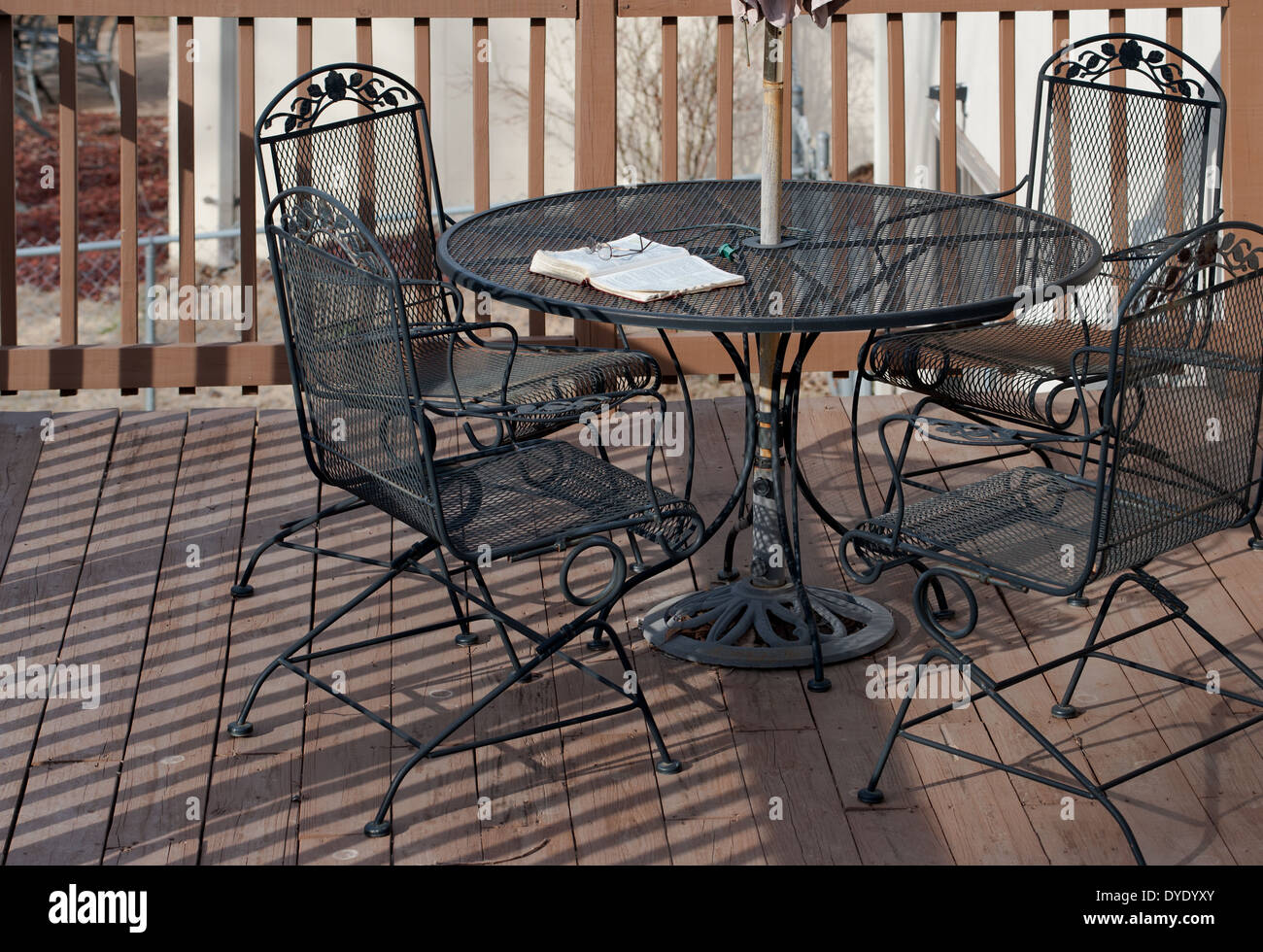 deck wrought iron table. Bible Lies Open On A Wrought Iron Table Wooden Deck