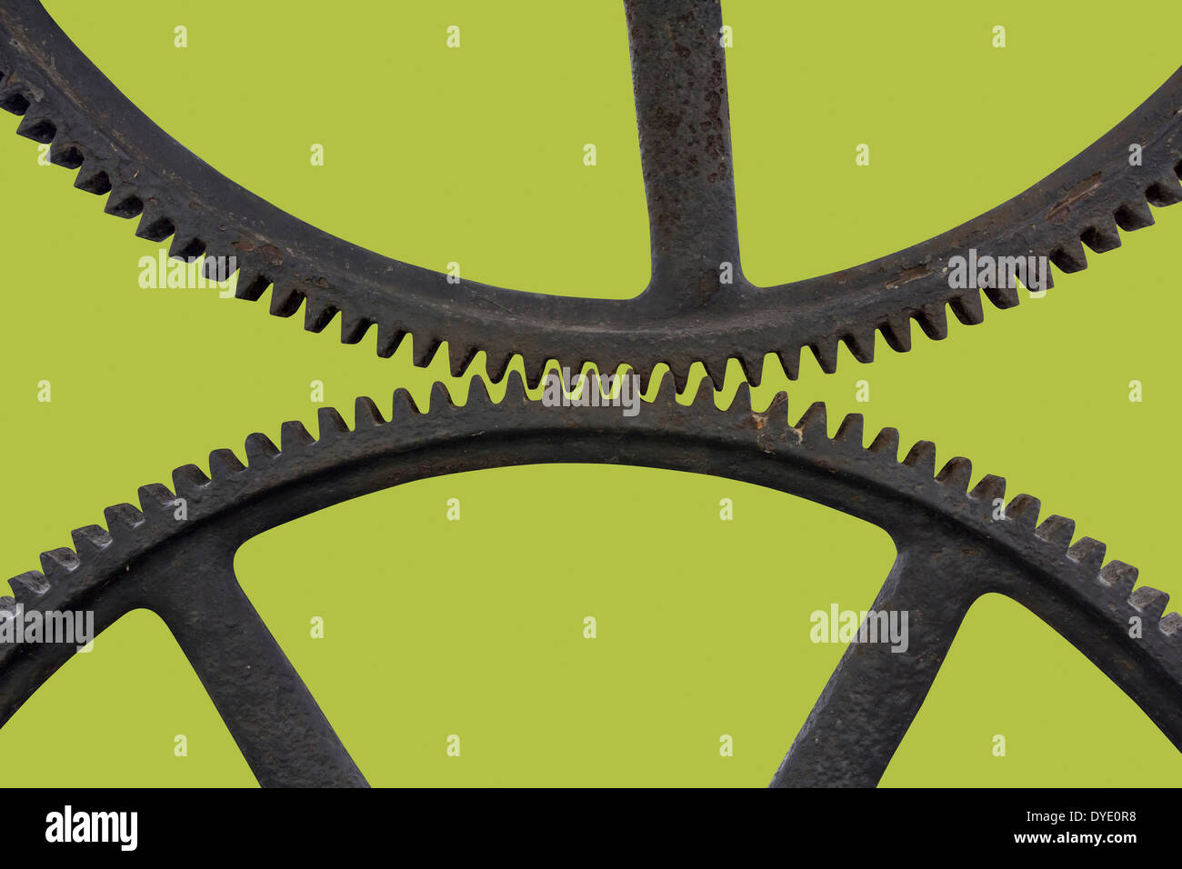 Two old Metal rusty Cog Gears on a green background - Stock Image