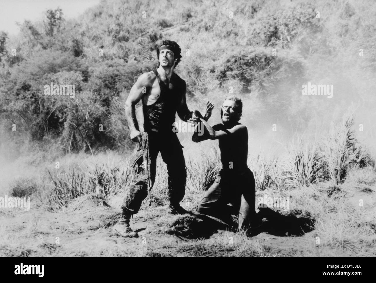 Sylvester Stallone and Unidentified Actor, on-set of the Film, 'Rambo: First Blood Part II', 1985 - Stock Image