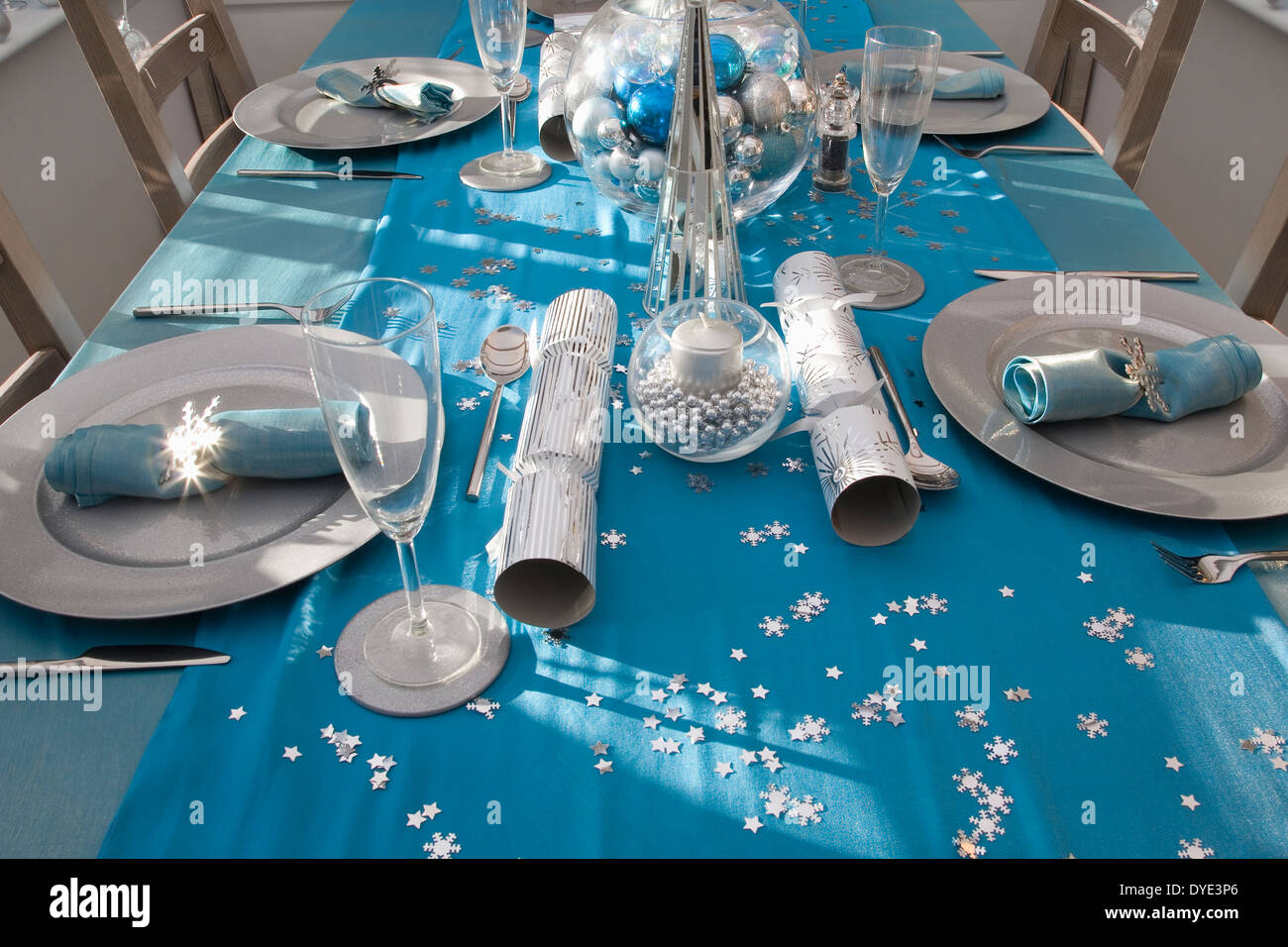 Blue And Silver Christmas Dinner Table Set Up Stock Photo