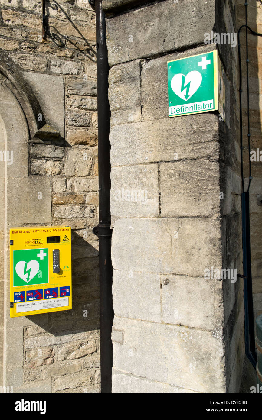 A public access defibrillator mounted to a wall in Malmesbury, Wiltshire, UK - Stock Image