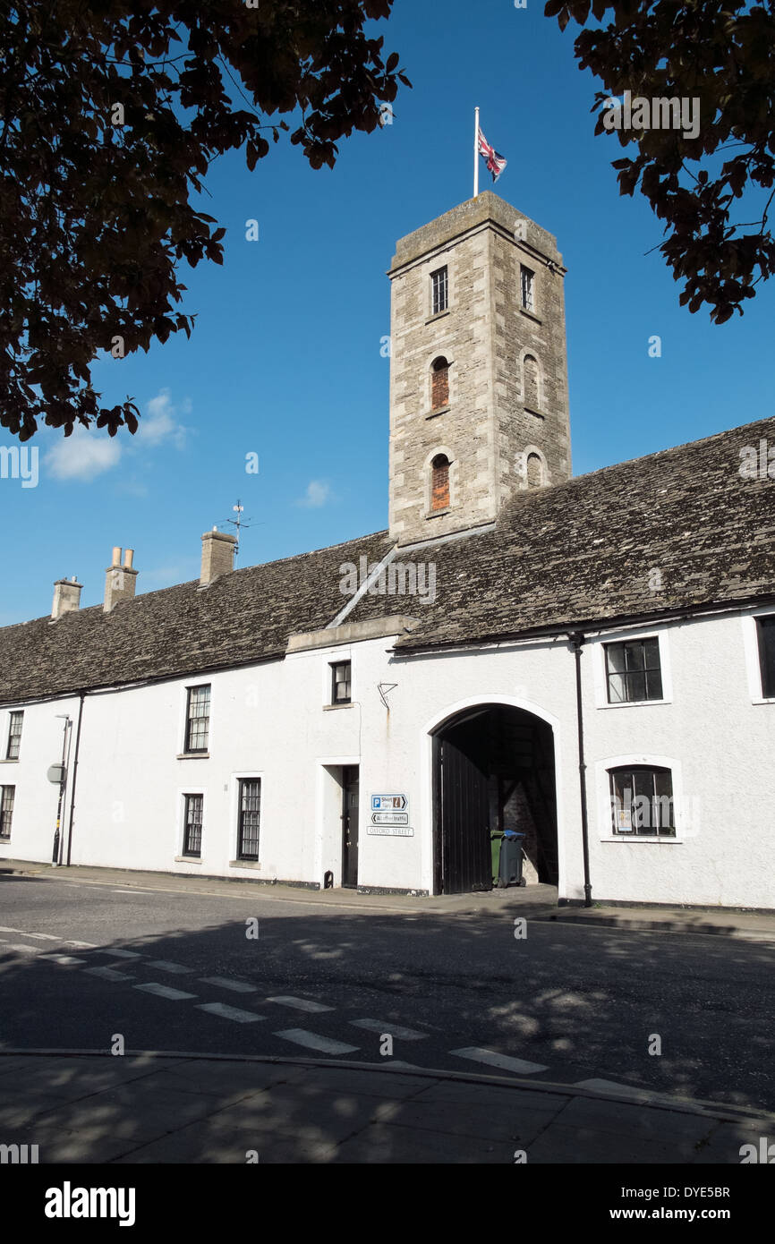 The medieval Tower House flying the Union Flag on a sunny day on Oxford St in the cotswold market town of Malmesbury, Wiltshire - Stock Image