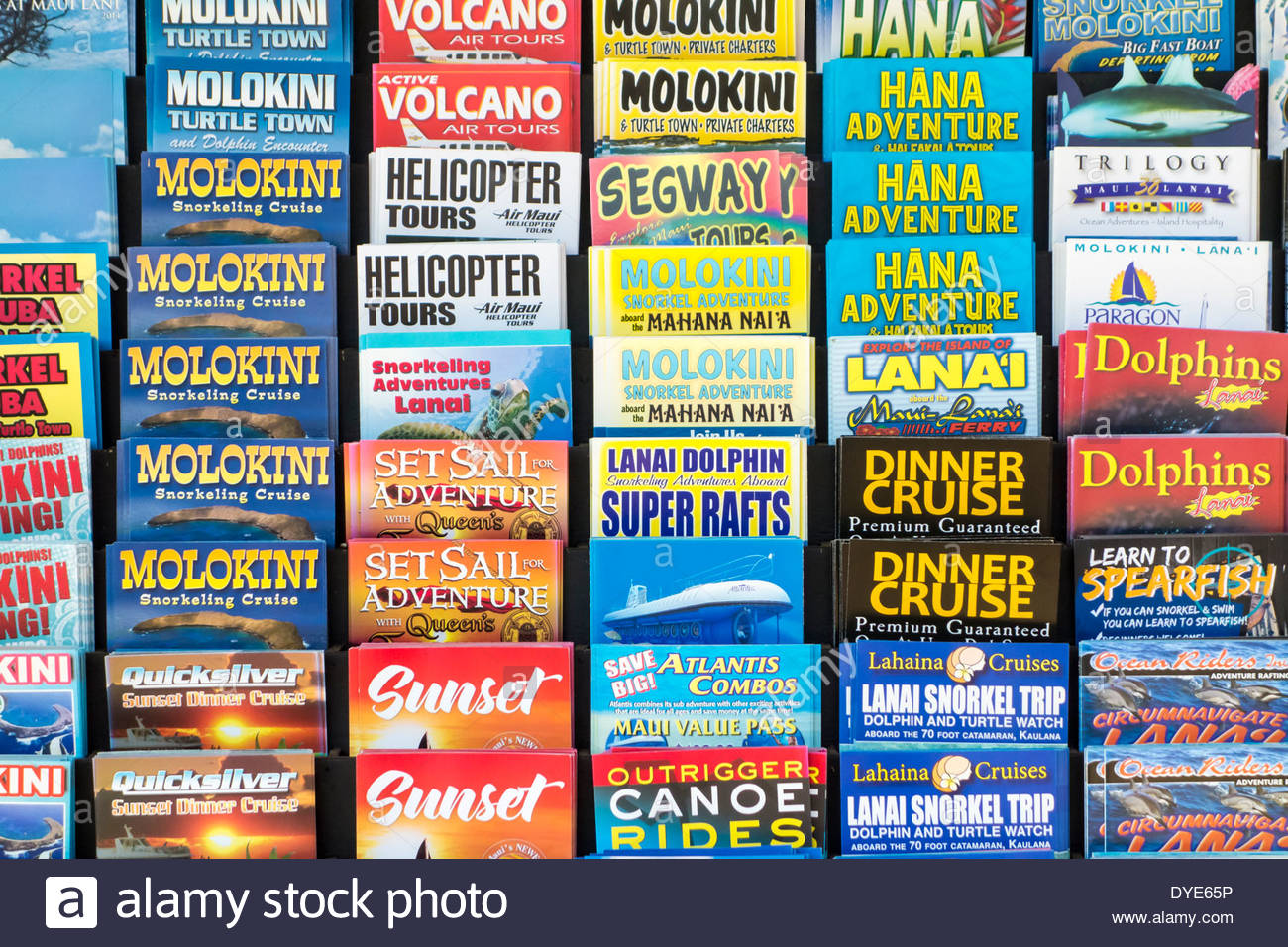 Tour brochures on display in town of Lahaina on the island of Maui in the State of Hawaii USA - Stock Image