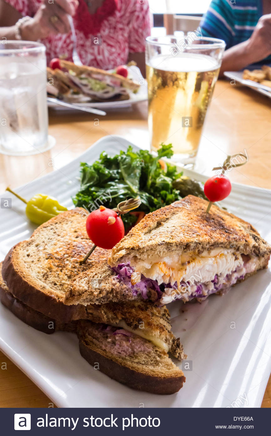Fish Reuben sandwich for lunch at Lahaina Fish House restaurant in Lahaina on the island of Maui in the State of Hawaii USA - Stock Image