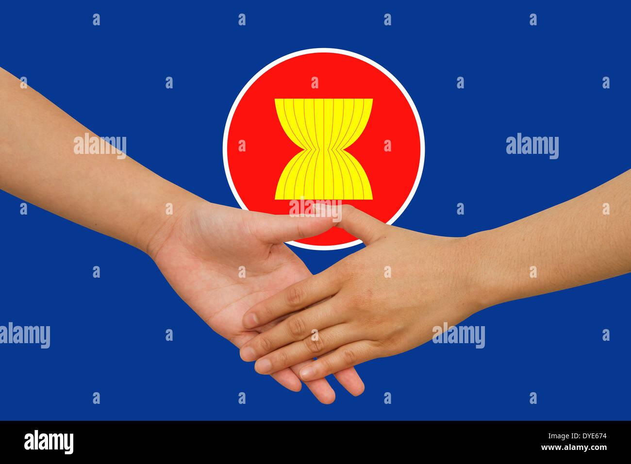 ASEAN Economic Community in businessman handshake - Stock Image