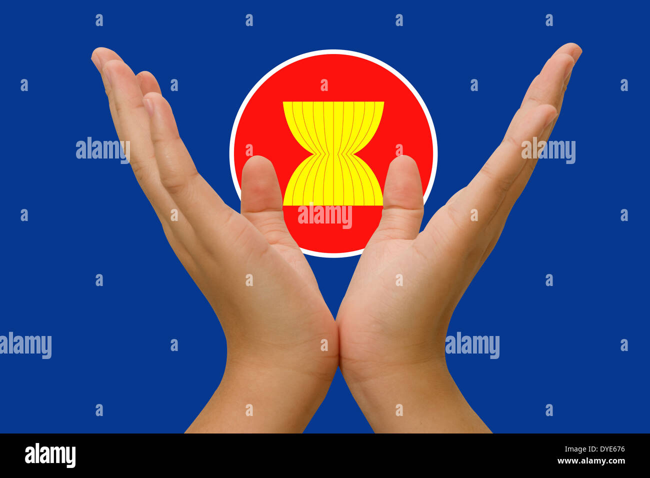 Open hands holding icon of Asean Economic Community - Stock Image