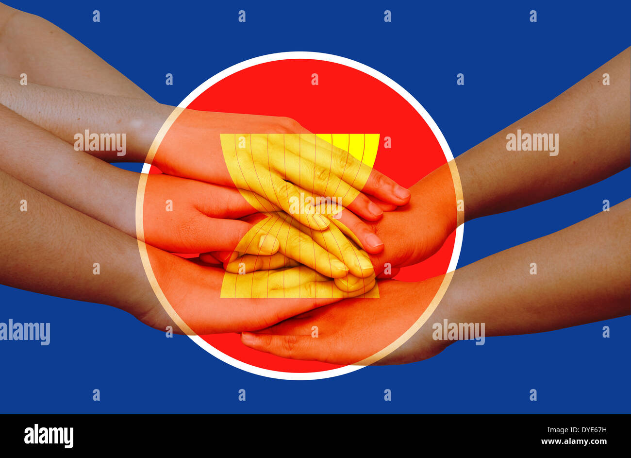 Hands on top of each other showing unity with icon of Asean Economic Community - Stock Image