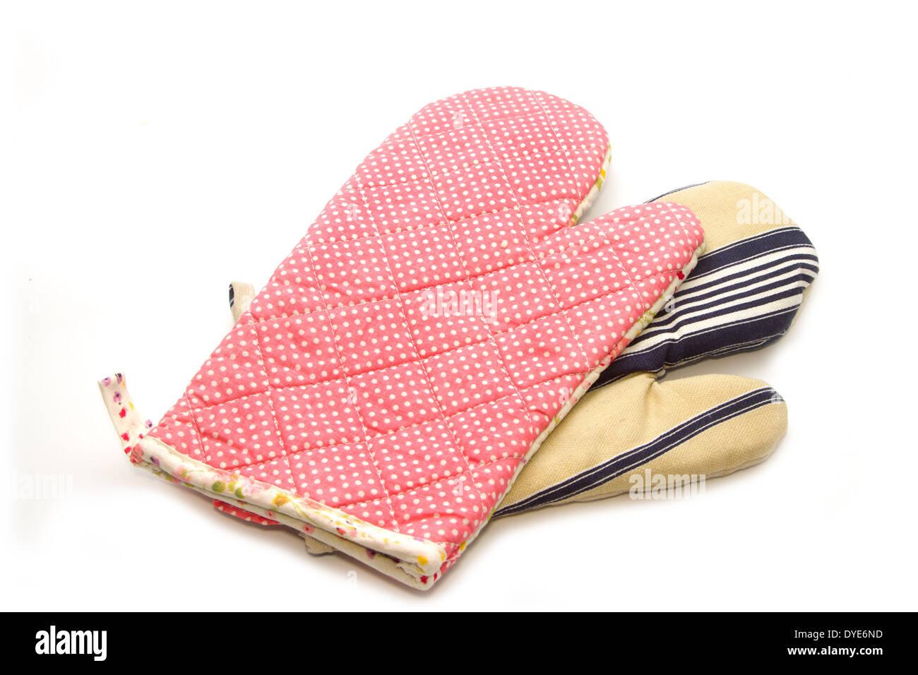 quilted heat protective mitten, kitchen utensils - Stock Image