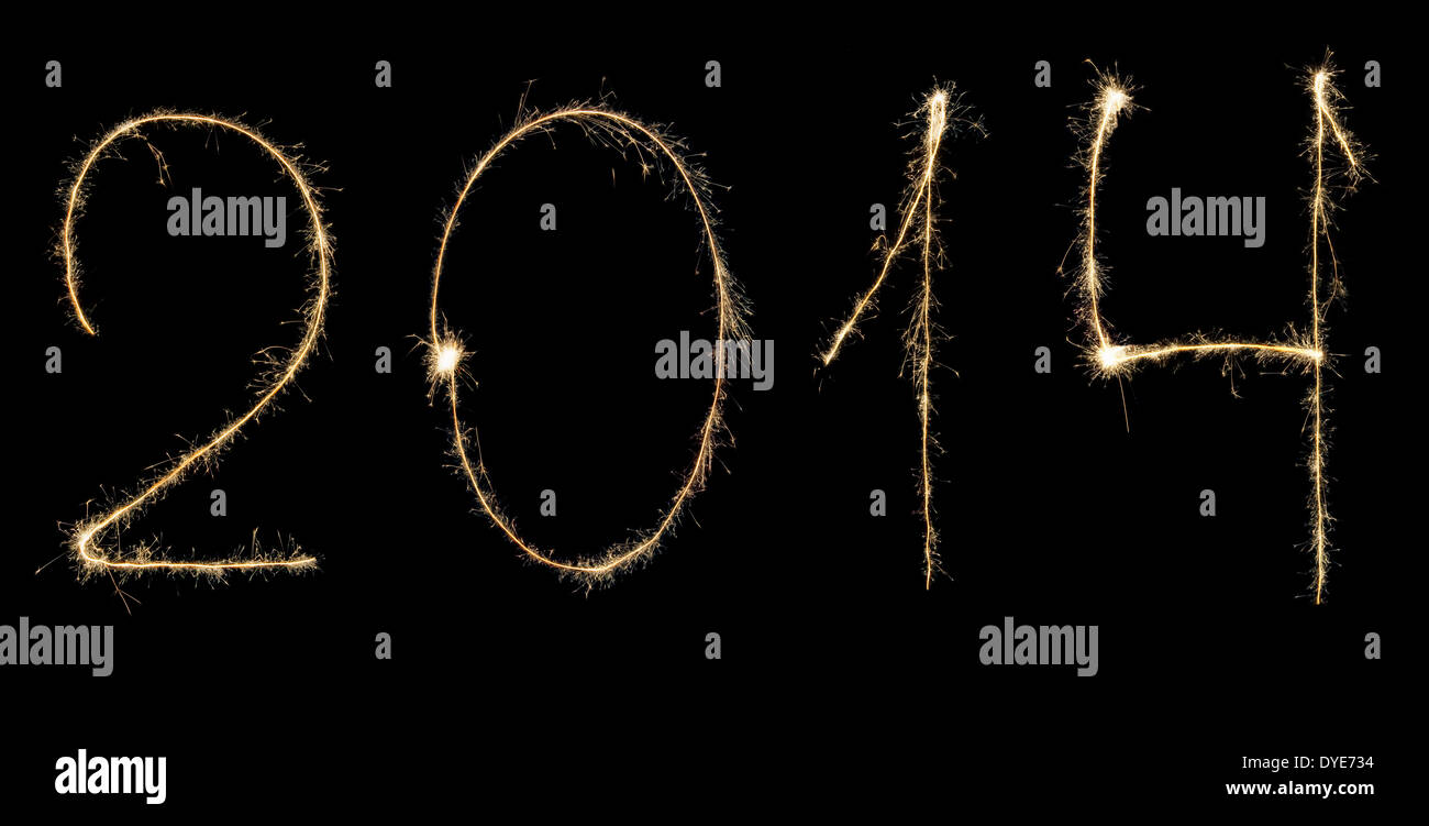 Digits 2014 written with sparklers isolated on black - Stock Image