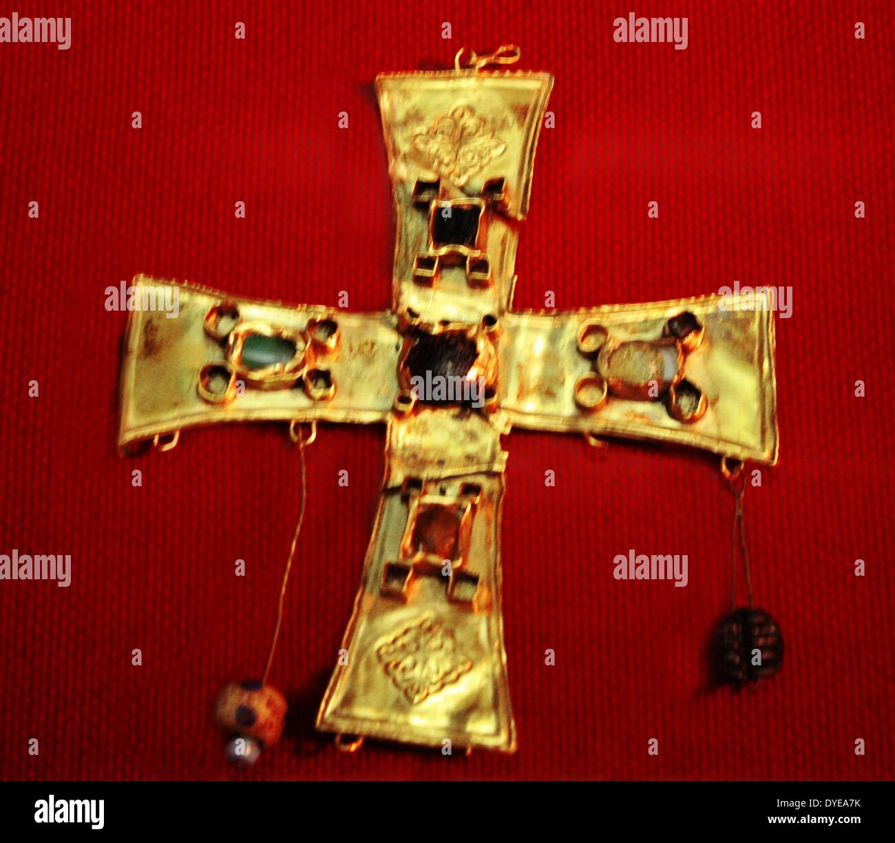 Gold cross with glass beads and fine stones. Barcelona - Stock Image