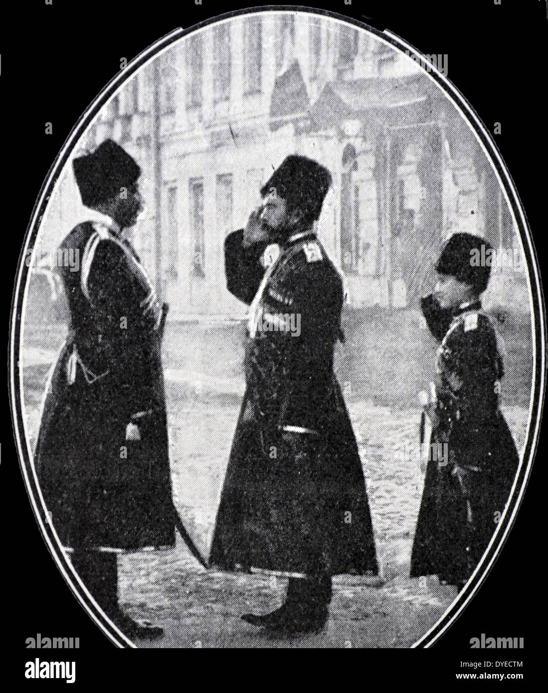 Tsar Nicholas II of Russia with Tsarevich salutes an officer Stock Photo