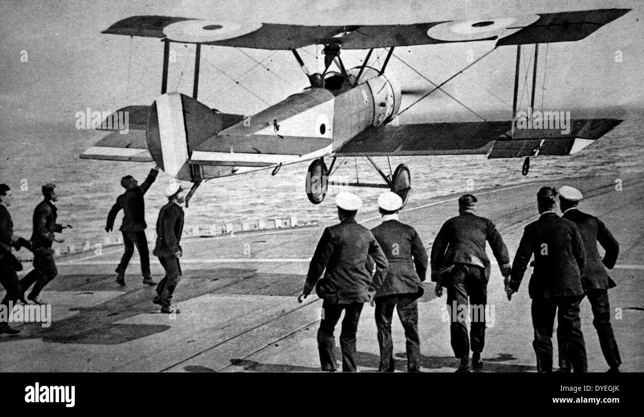 First landing of an aeroplane on the deck of a warship - Stock Image
