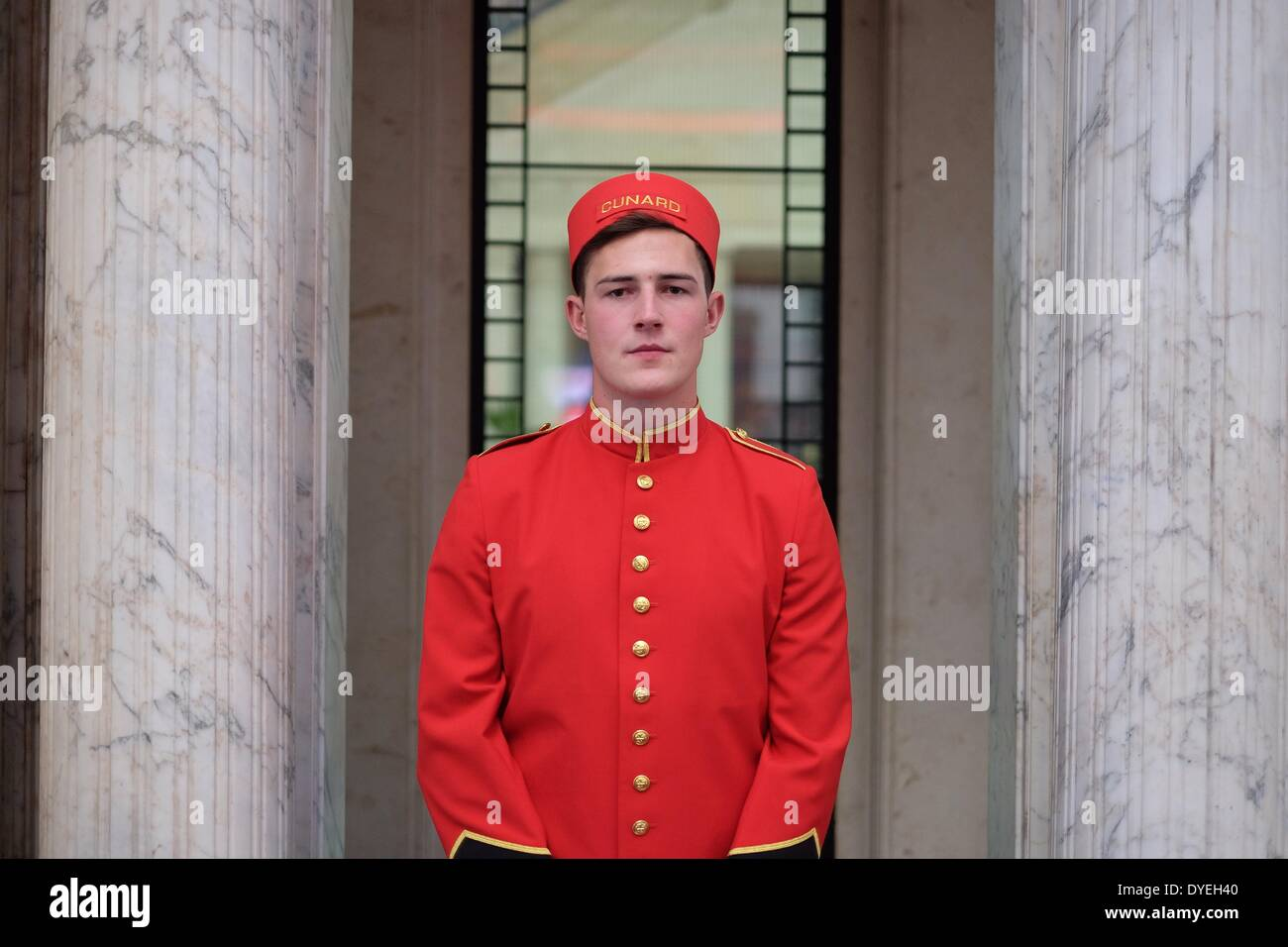 Cunard Building, Liverpool. 16th April, 2014. A Cunard bellboy welcomes guests to the launch of the '3 Queens. 1 magnificent city' event in Liverpool. 3 Cunard ships will visit the city in 2015. Credit:  Peter Carr/Alamy Live News - Stock Image