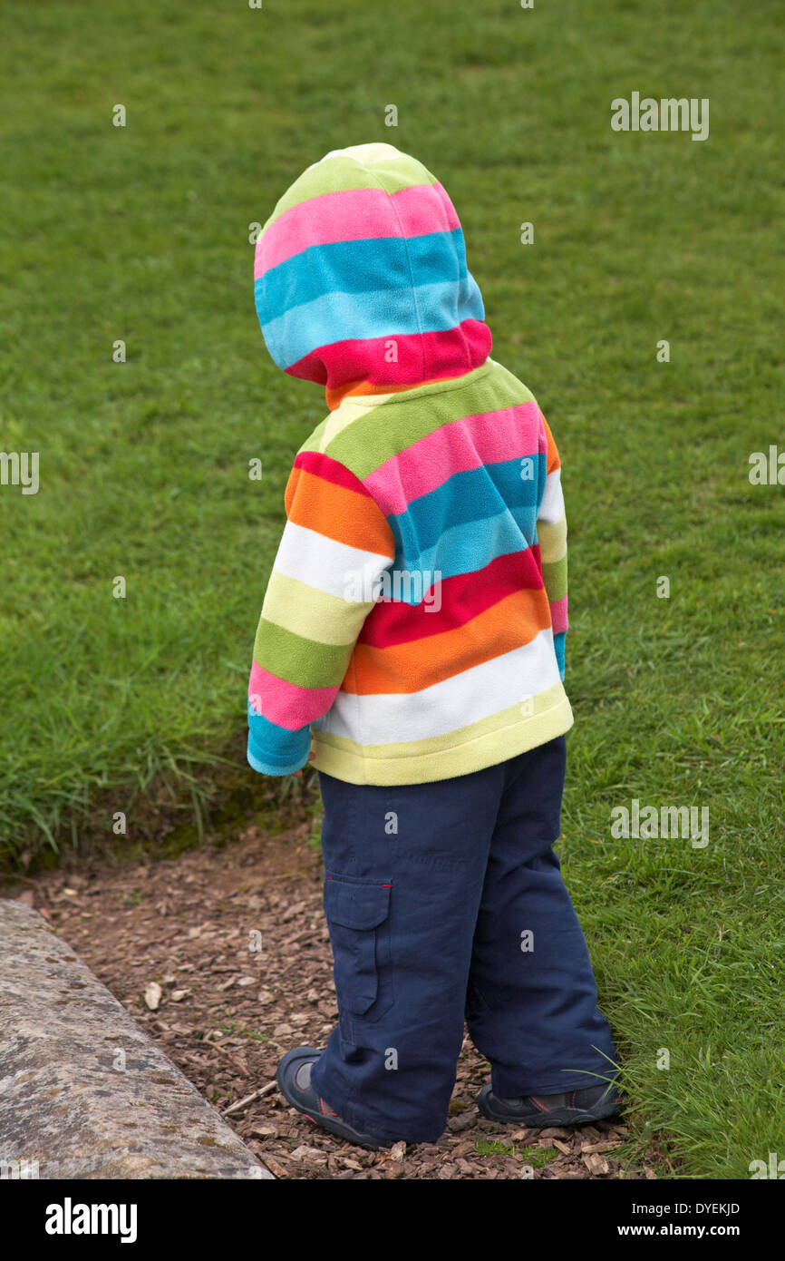 toddler in striped hooded top - Stock Image