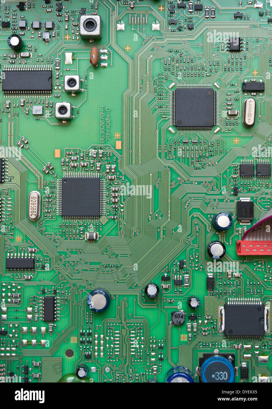 Detail of integrated circuit board with chip - Stock Image