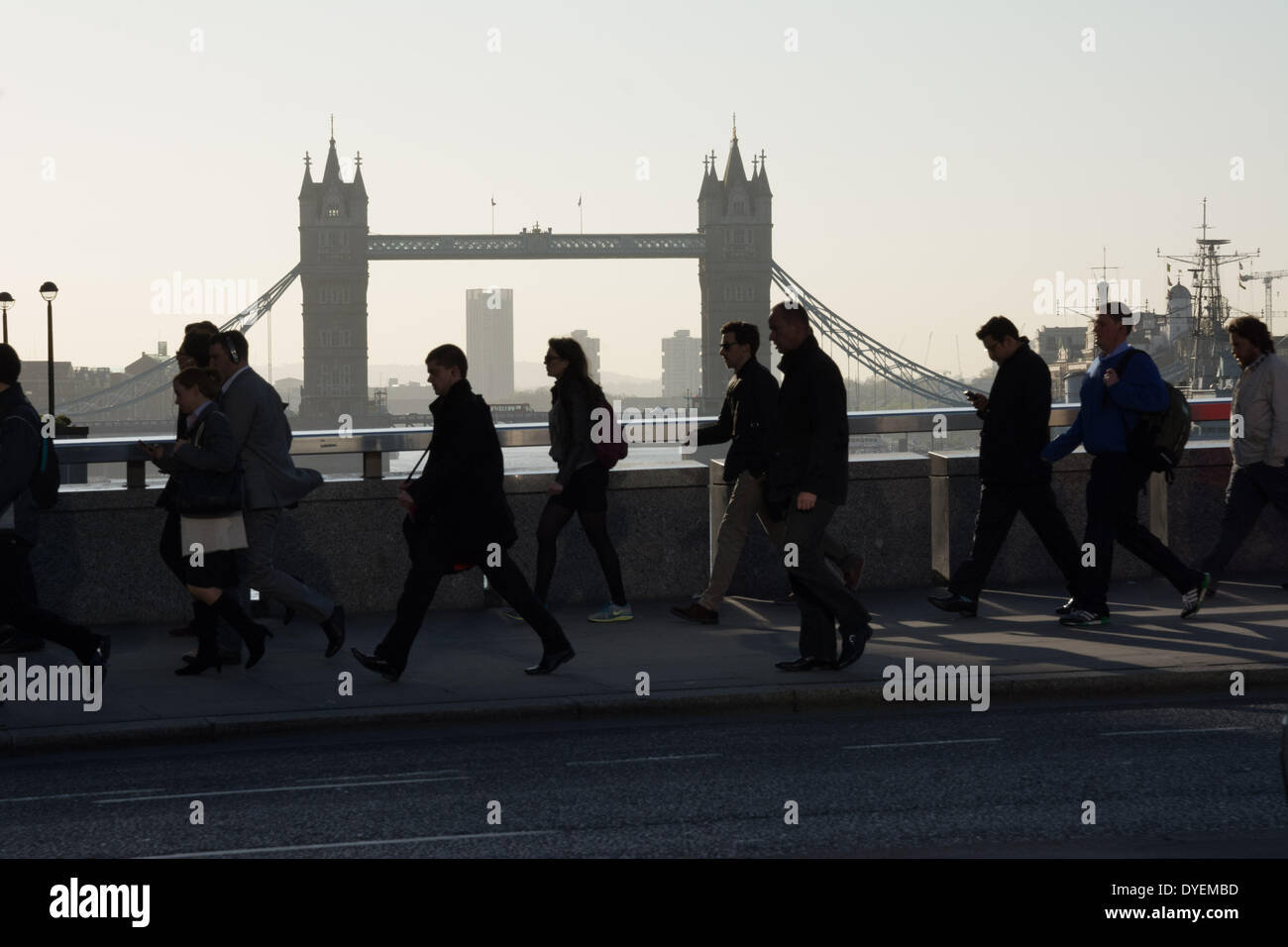 London UK. 16 April 2014. Commuters stream across London Bridge with Tower Bridge in the distance as London wakes to another beautiful sunny morning Credit:  Patricia Phillips / Alamy Live News - Stock Image