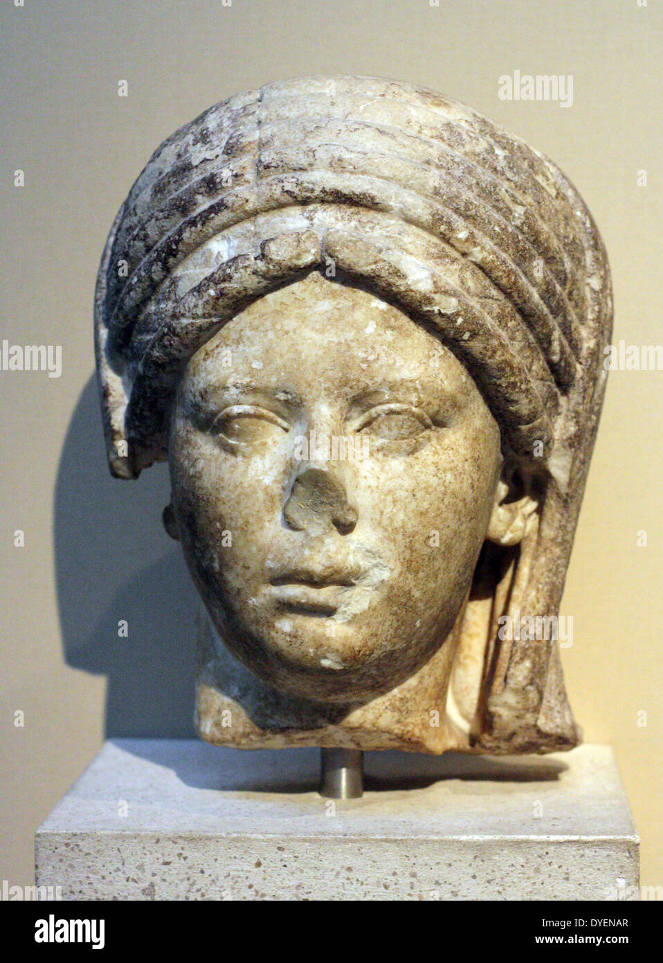 Marble head from a portrait statue of a veiled priestess of the goddess Vesta.  Roman, made about AD 100-20. - Stock Image