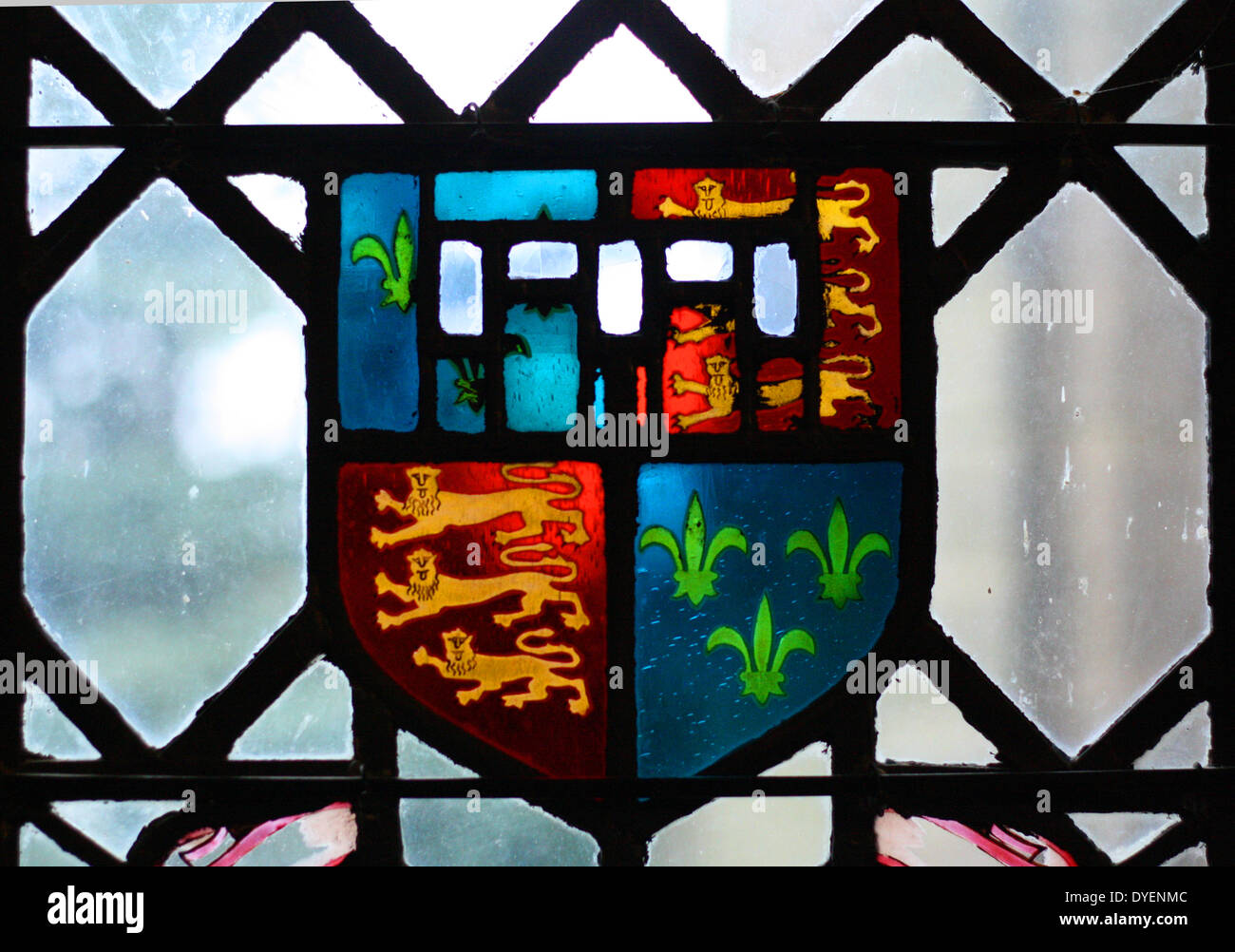 Coats of arms displayed on stained glass windows at Warwick castle - Stock Image