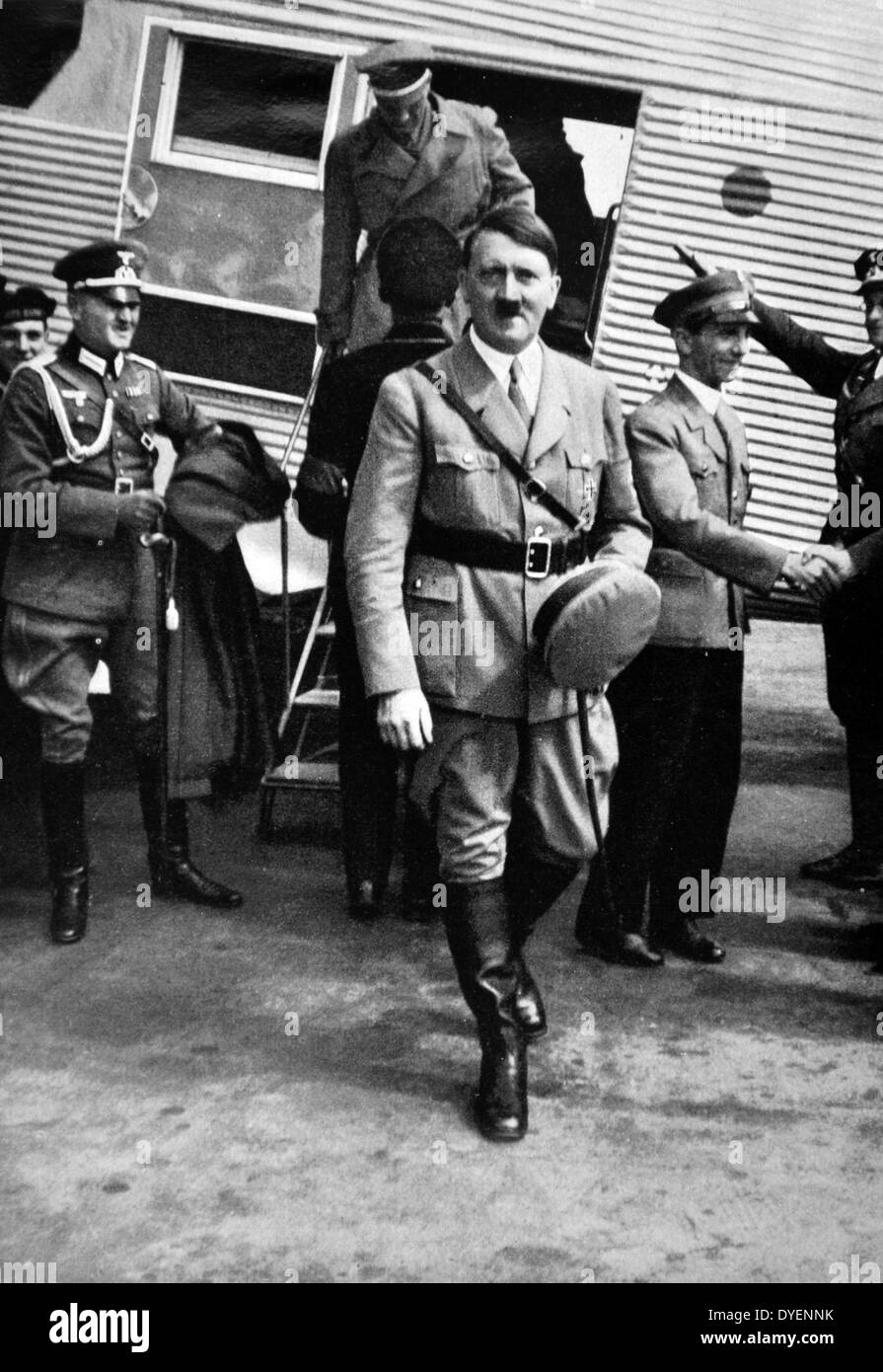 Adolf Hitler arriving at an airfield in Germany accompanied by Dr Josef Goebbels - Stock Image