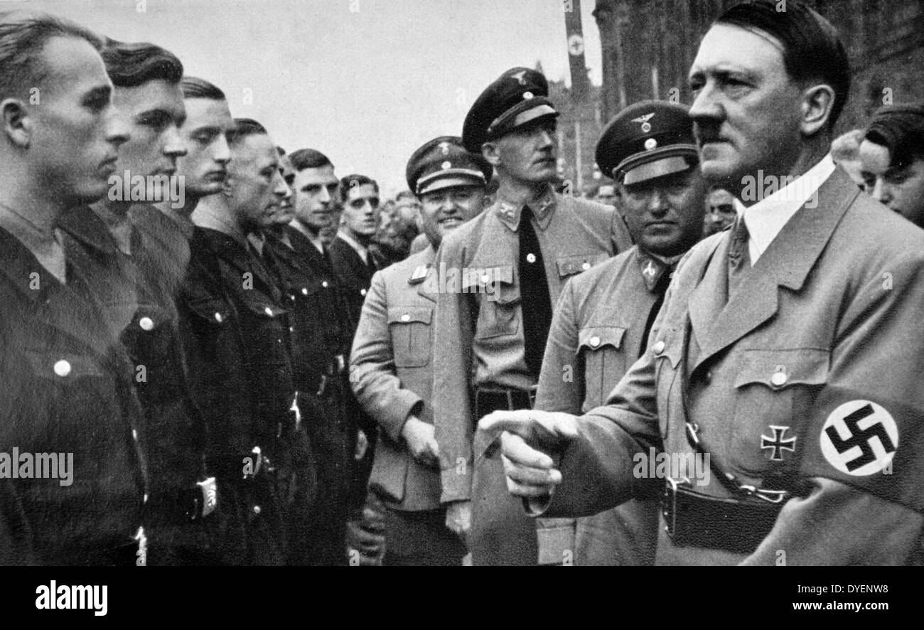 Adolf Hitler with Robert Ley 1890 – 25 October 1945) greeting young Nazi Labour Movement members 1935 - Stock Image