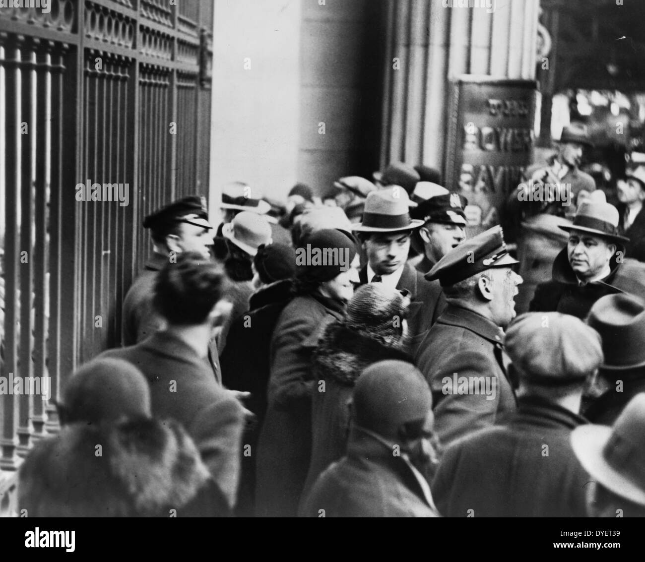 Police announce the news to depositors that the bank is closed. 19330101. - Stock Image