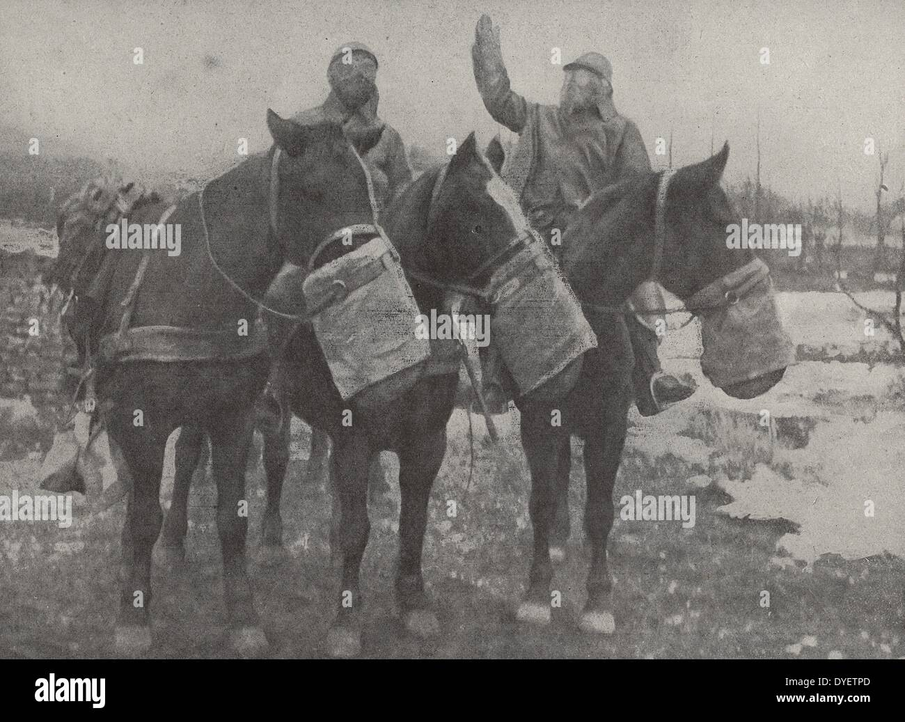 French cavalry soldiers with horses, stopped by a sentry with a warning: Attention, gas cloud, ahead. This column carrying - Stock Image