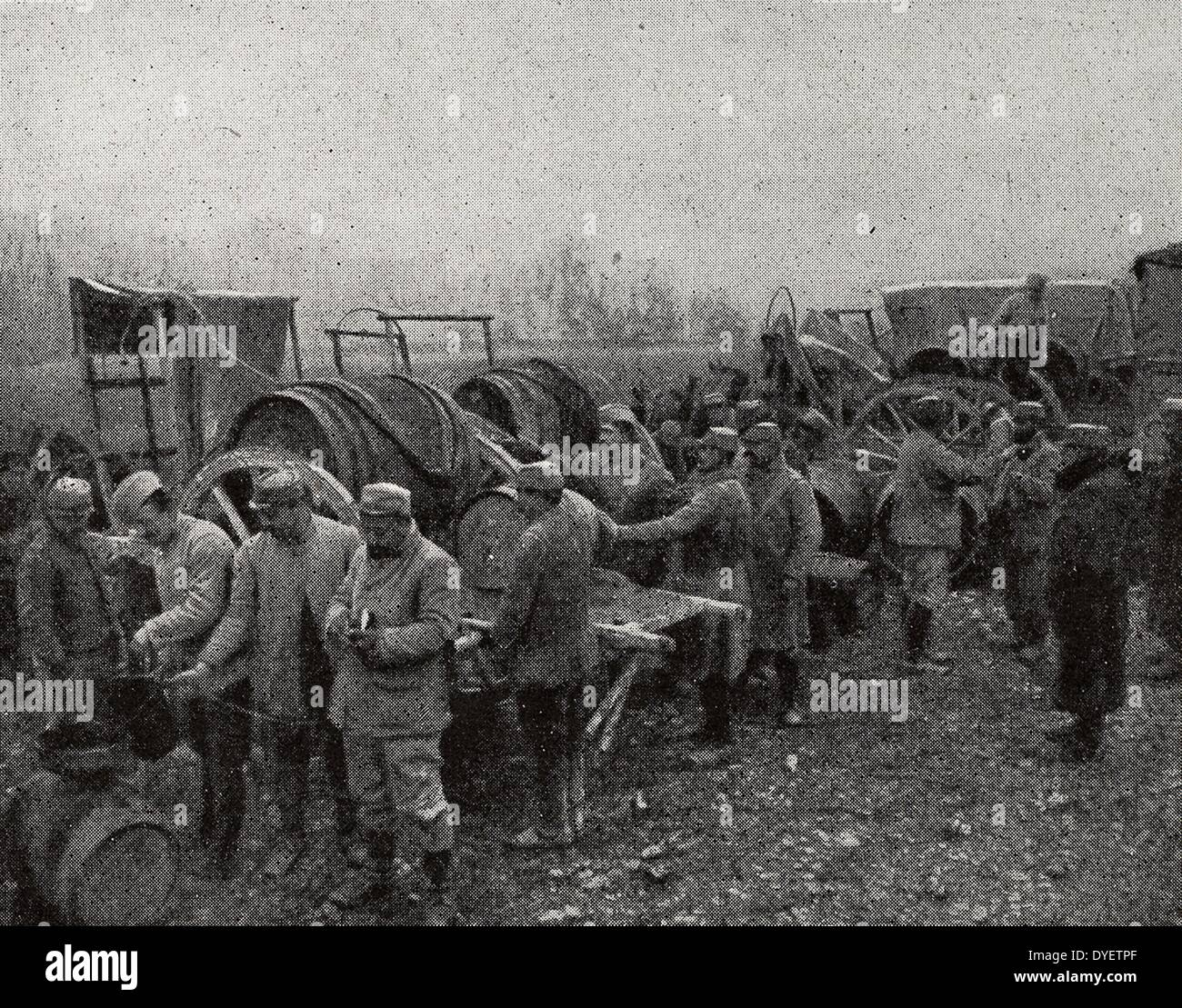 French soldiers with horses, stopped to take a rest during a break in the battle. Meuse region of France, World War One 1916 - Stock Image