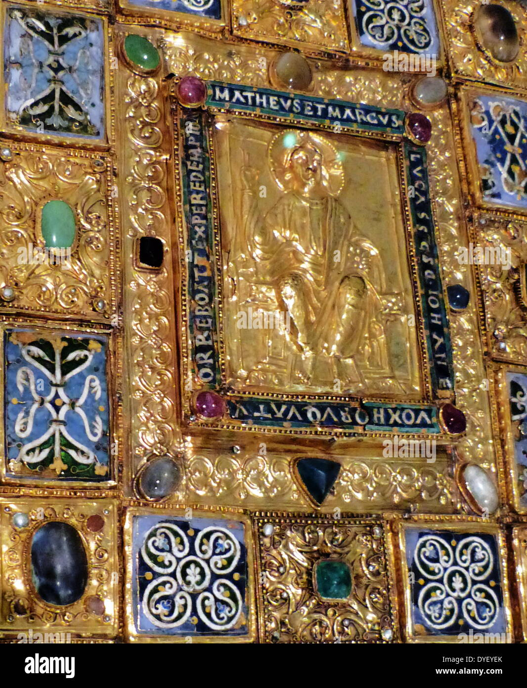 Bejewelled religious plaque with relief image and Latin Inscription. - Stock Image