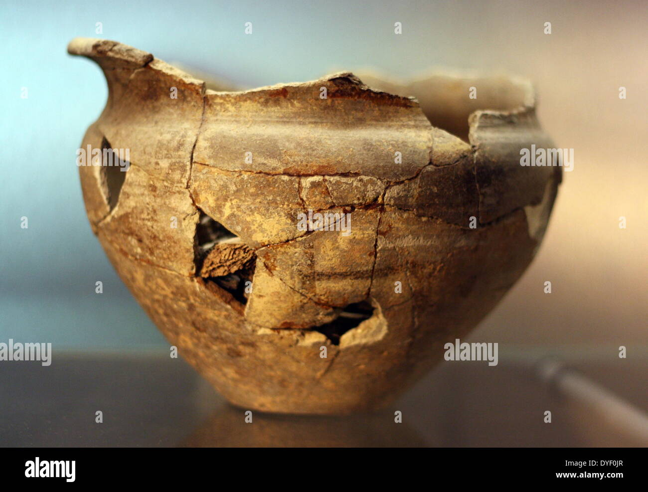 Ancient Roman pottery artefact reconstructed from multiple pieces. - Stock Image