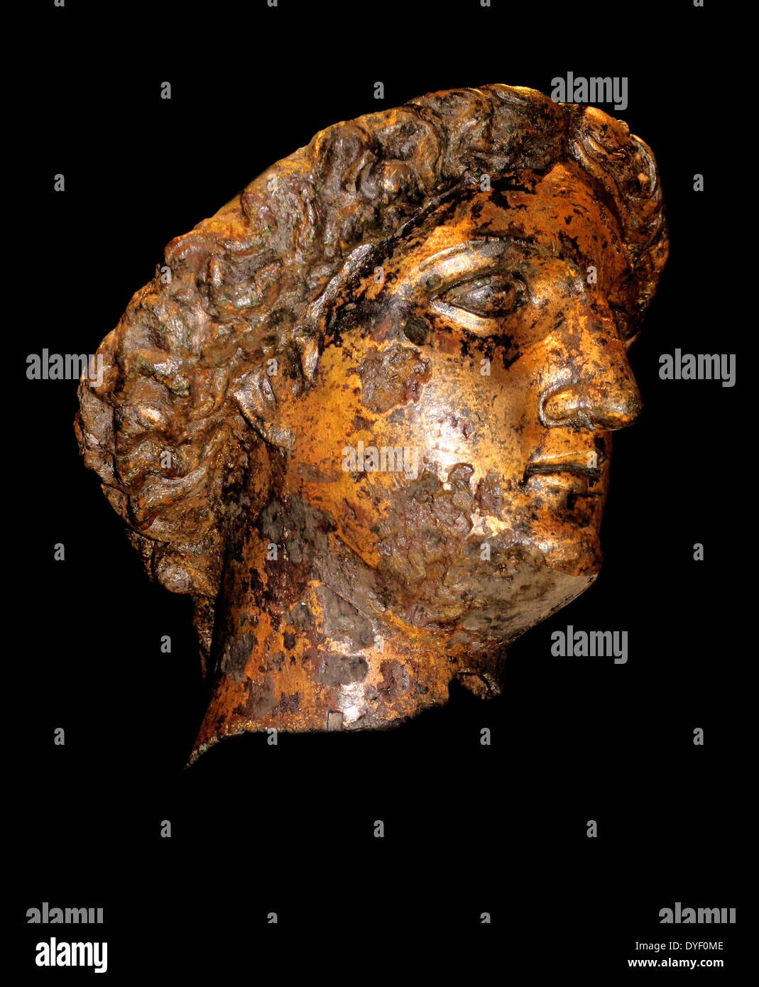 Gilt bronze head of Sulis Minerva from a cult statue - Stock Image