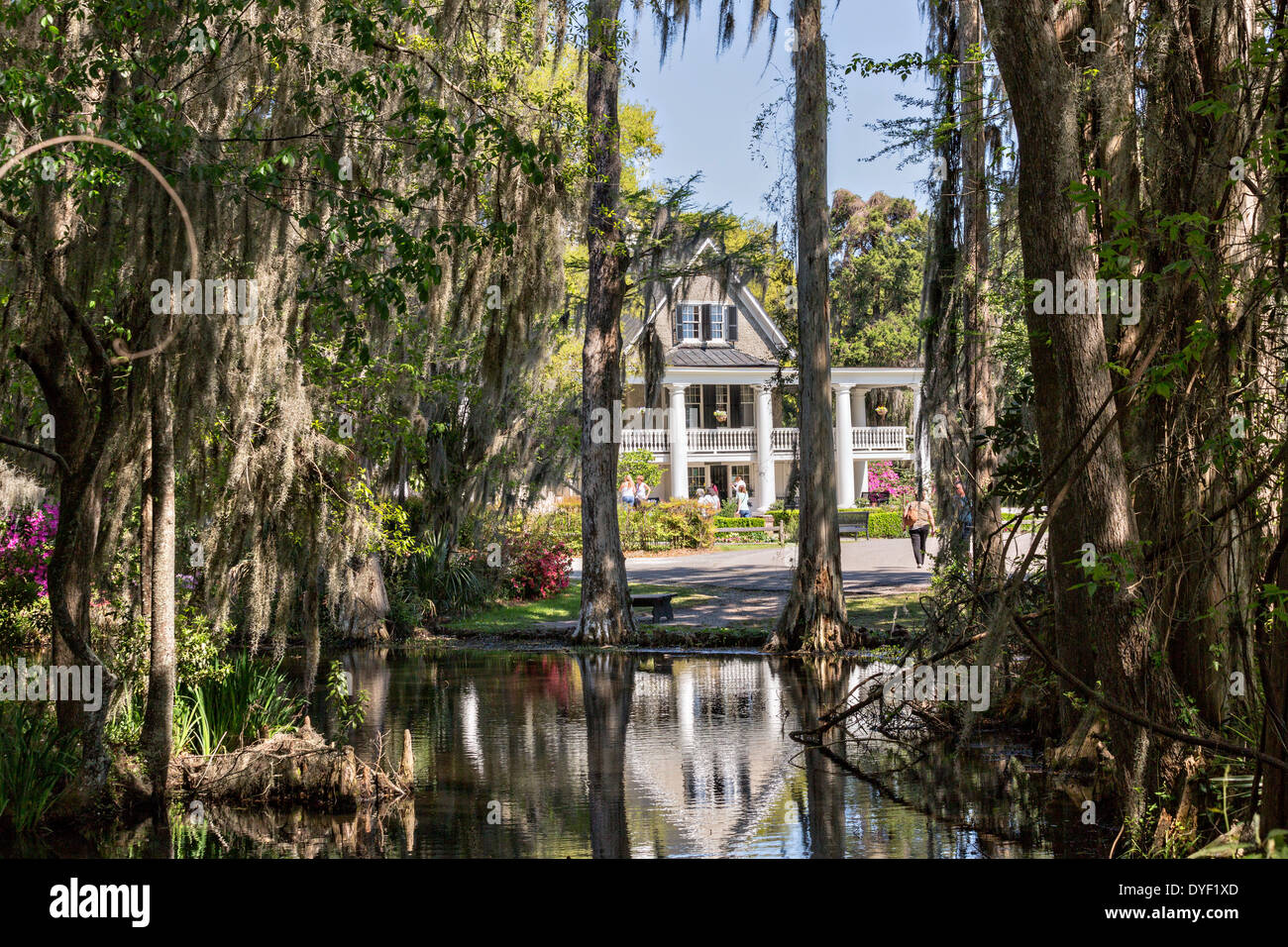 Plantation house seen from the garden lake at Magnolia Plantation ...