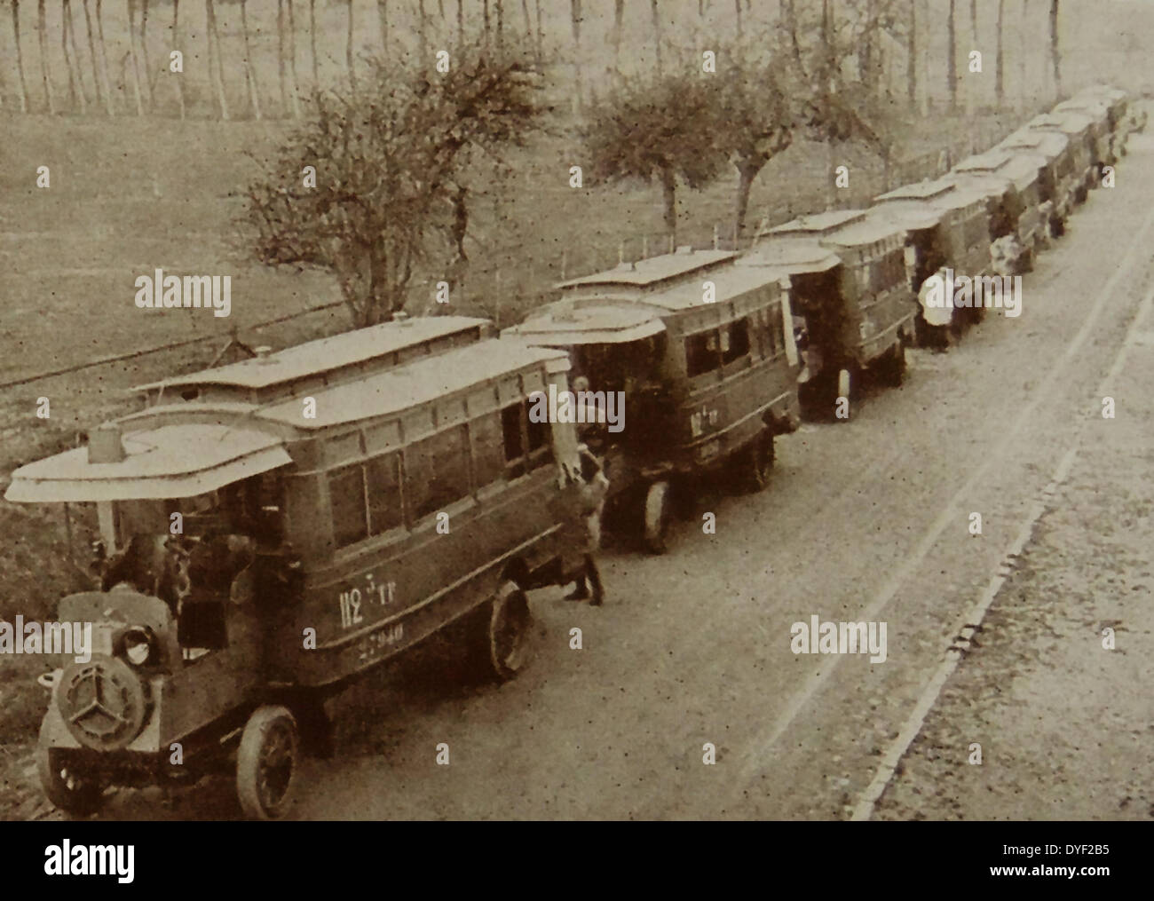 French military transport of troops by bus. - Stock Image