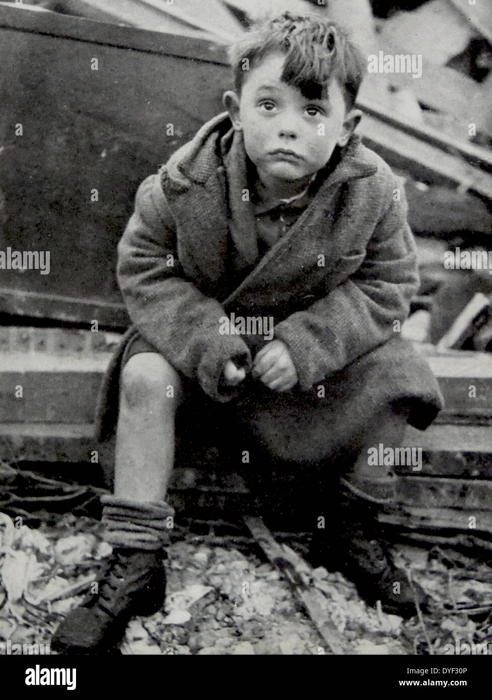 An orphaned child looks shocked after surviving the Blitz on London, by German V2 Rockets 1944 Stock Photo