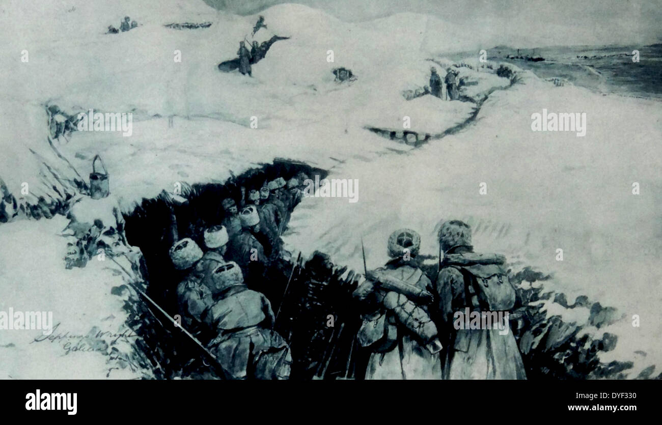 World war one Russian troops advance through a snow covered trench in Galicia. - Stock Image