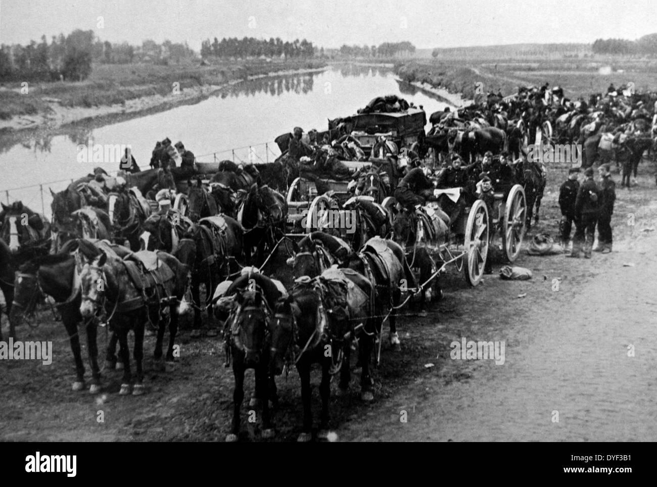A photograph from the First World War, showing troops on horseback along a riverbank. - Stock Image