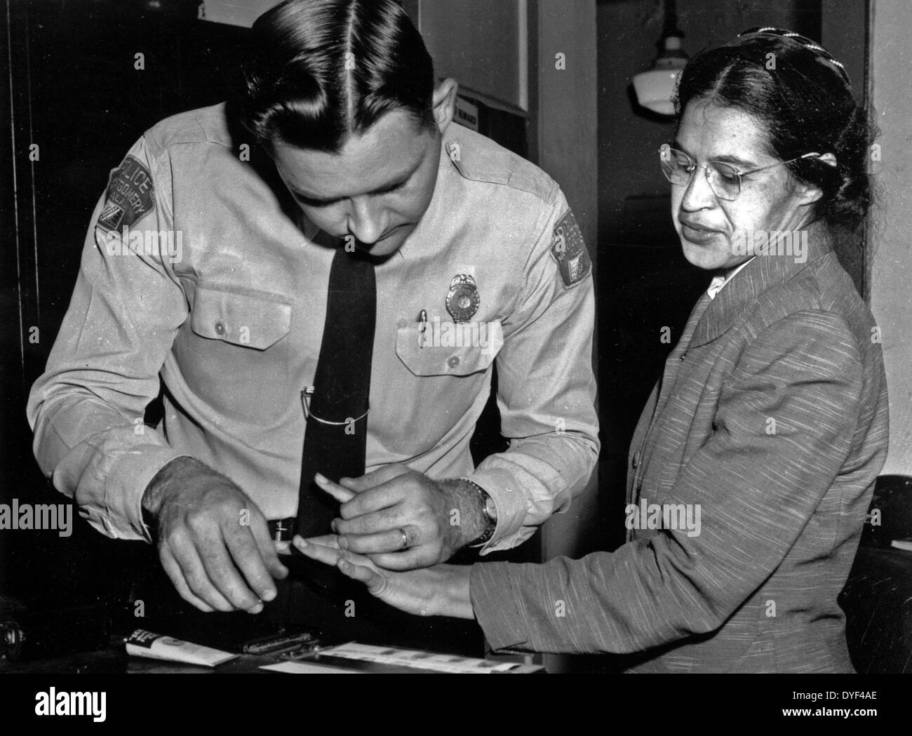 Rosa Parks is fingerprinted by police Lt. D.H. Lackey in Montgomery 1956. - Stock Image