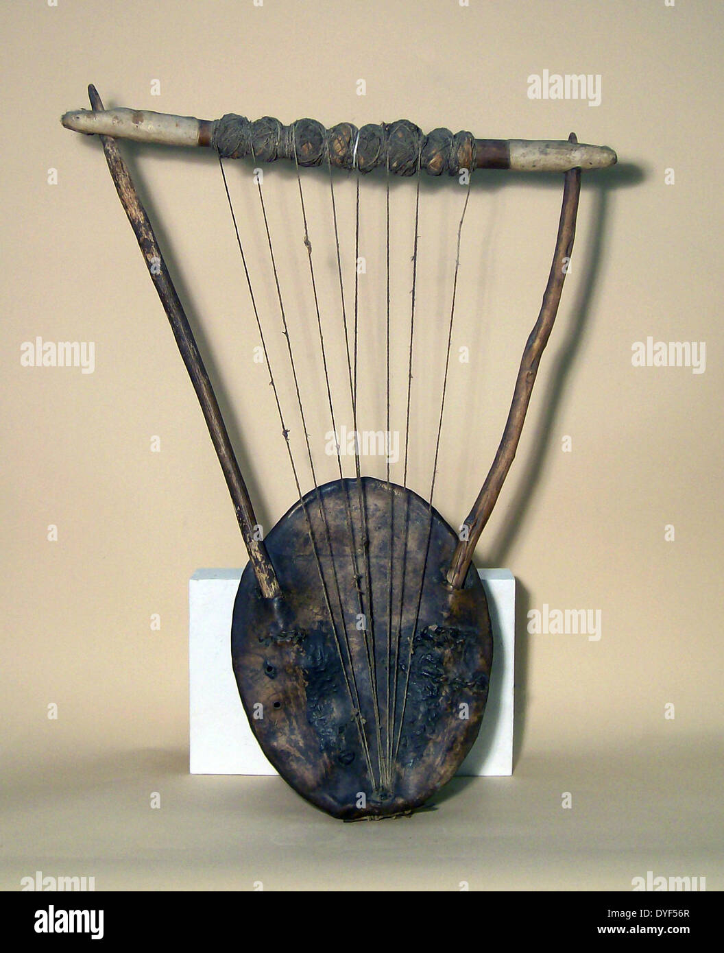 Primitive stringed instrument,  probably African tribal. - Stock Image