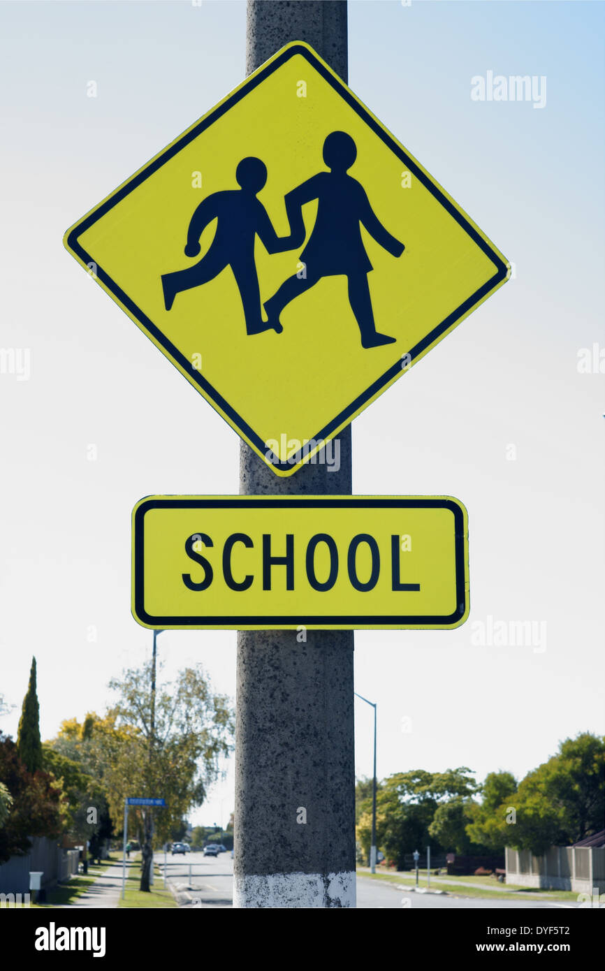 School crossing sign warning drivers they are entering a school zone - Stock Image