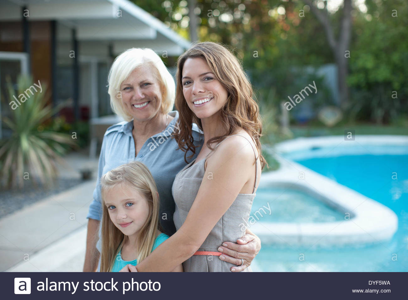 Three generations of women smiling together - Stock Image