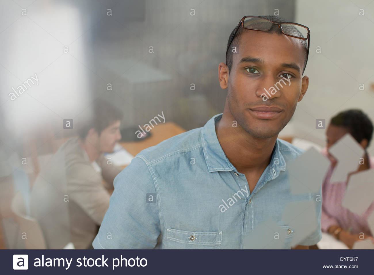 Portrait confident businessman  in conference room - Stock Image