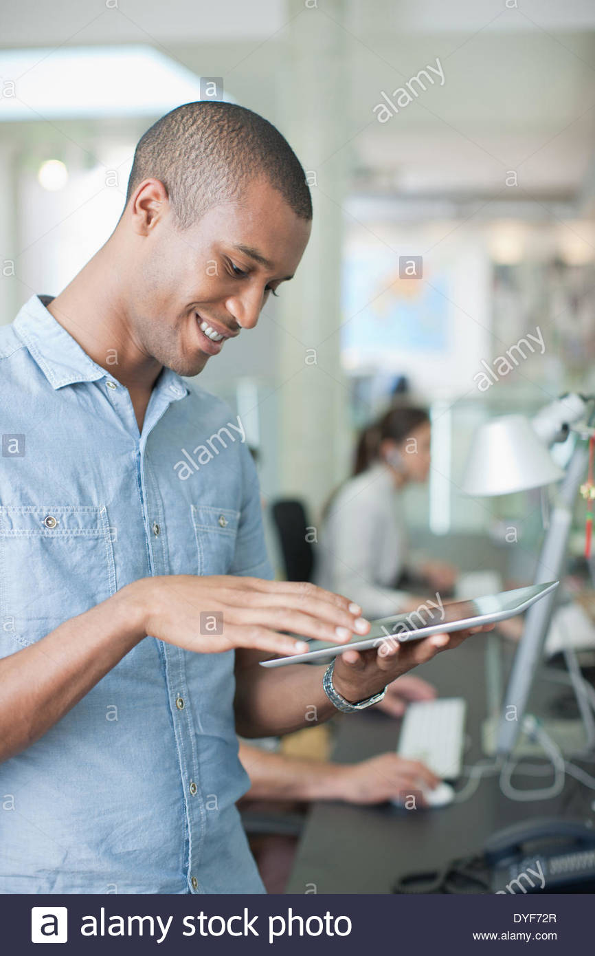 Man using digital tablet in office Stock Photo