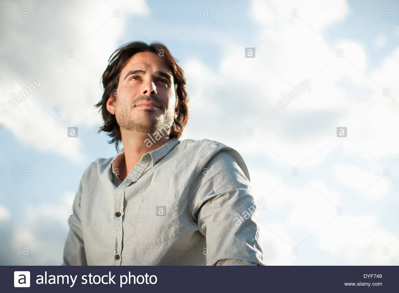 Pensive businessman looking in front outdoors - Stock Image