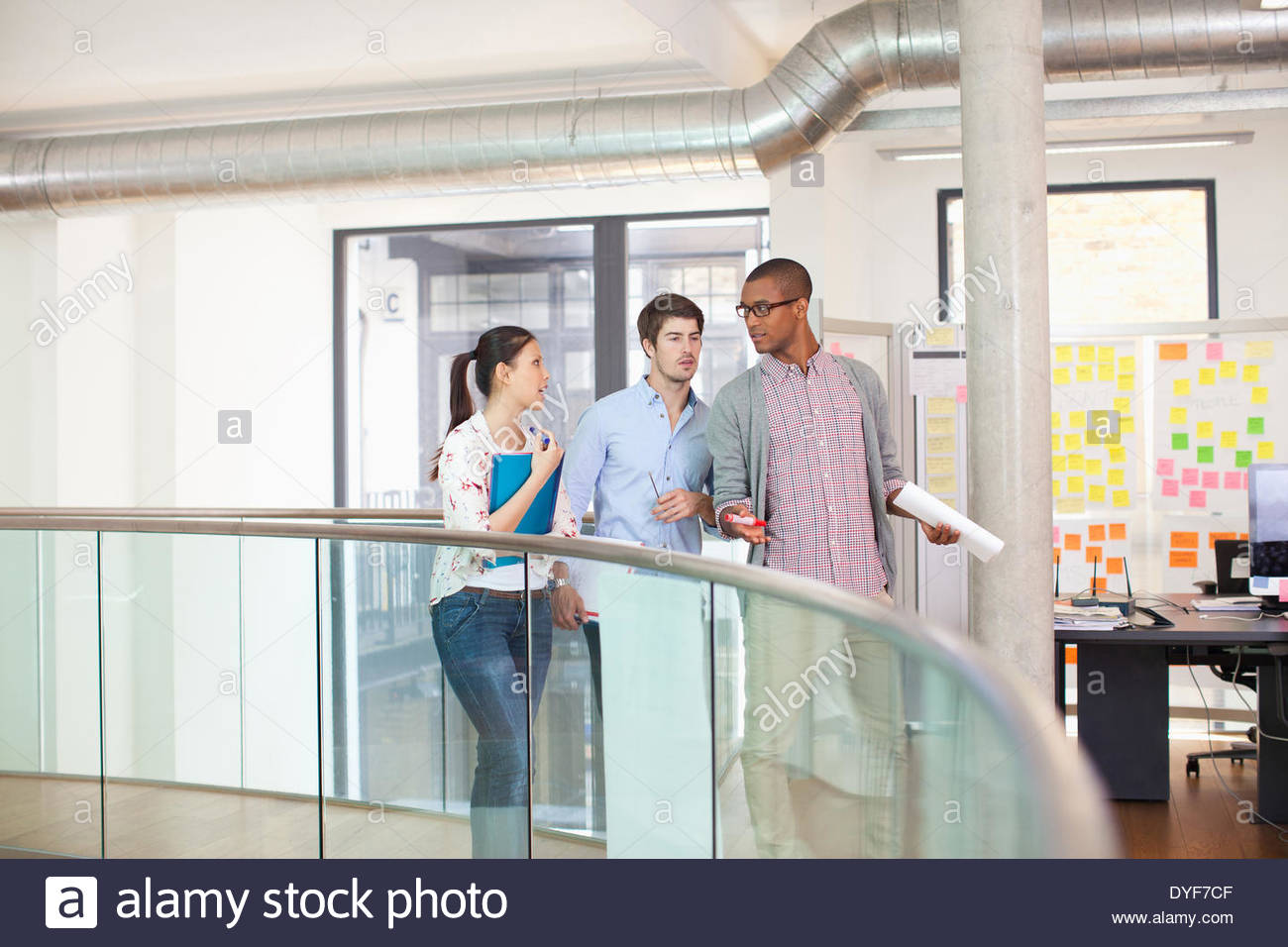 Three business people having discussion - Stock Image